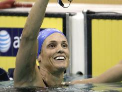 Dara Torres waves to the crowd after finishing second in the women's 50-meter freestyle at the U.S. Winter Nationals on Dec. 1 in Atlanta.