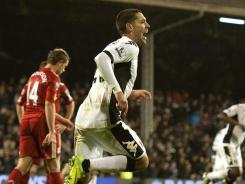 American Clint Dempsey celebrates his 85th-minute goal to give Fulham a 1-0 lead. His 37th career Premier League goal set the record for most by an American player.