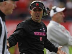 Carl Pelini was defensive coordinator for the past four years at Nebraska under his brother Bo.