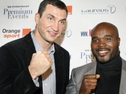 Wladimir Klitschko, left, has been forced to pull out of his fight scheduled for Saturday against  Jean-Marc Mormeck after undergoing an operation to remove a kidney stone.