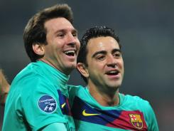 Barcelona's Lionel Messi, left, and Xavi Hernandez were among the finalists for the FIFA Ballon d'Or, awarded to the best player of the year. Messi has claimed the award the last two years.