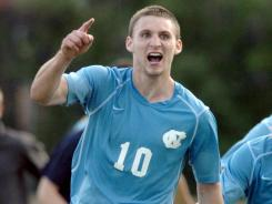 Billy Schuler celebrates one of his eight game-winning goals this season, an overtime tally in the tournament's third round against Indiana.
