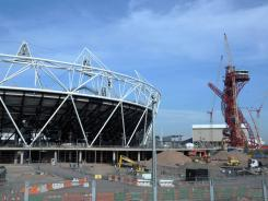 Seen here are Olympic Stadium, left, and the ArcelorMittal Orbit at Olympic Park under construction in London. Auditors have warned organizers that they are in danger of exceeding the $14.6 billion budget for the 2012 Games.