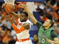 Syracuse guard Scoop Jardine, left, pulling down a rebound against Marshall's Dago Pena, tallied 10 points, five rebounds and four assists in the 62-56 win.