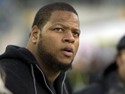 Defensive tackle Ndamukong Suh is not permitted to be around his Detroit Lions teammates while he serves his two-game ban. To complicate matters, he got into a car accident in his native Portland, Ore. over the weekend.