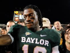Robert Griffin III is in a tight Heisman race with Trent Richardson and Andrew Luck.