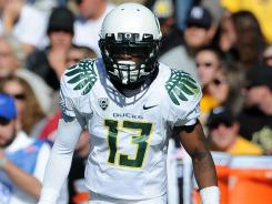 Oregon cornerback Cliff Harris had missed the team's last six games before being dismissed.