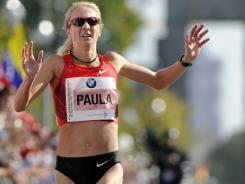 Paula Radcliffe crosses the finish line of the Berlin Marathon on Sept. 25, 2011. She finished third.