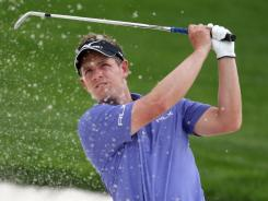 Luke Donald of England practices bunker shots in advance of this week's Dubai World Championship.