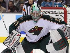 Matt Hackett replaced Josh Harding 71 seconds into the game and the Wild won their fifth consecutive game on the road.