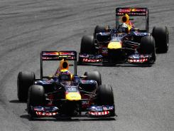 Australia's Mark Webber, front, overtakes his Red Bull Racing teammate Sebastian Vettel of Germany for the lead during the Brazilian Grand Prix in Sao Paulo, Brazil. Formula One will return to the U.S. in 2012 and race in Austin..