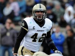"""He is one of the greatest men of character on our team,"" said Army quarterback Max Jenkins of linebacker Andrew Rodriguez, above."