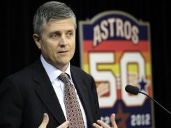 Newly hired Houston Astros general manager Jeff Luhnow answers a question during a news conference.