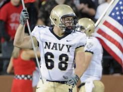 """It's always team first, him second,"" senior fullback Alexander Teich says of Navy teammate John Dowd, above."