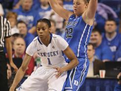 Kentucky guard A'dia Mathies (1) posts up against Duke guard Tricia Liston during the first half at Rupp Arena in Lexington, Ky.