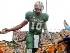 Bear of a quarterback:  Robert Griffin III led Baylor to a 9-3 record with wins against in-state rivals TCU, Texas Tech and Texas as well as then-No. 5 Oklahoma. His 192.3 passer rating led the nation, and he totaled 36 passing and 13 rushing touchdowns.