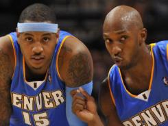 Carmelo Anthony, left, and Chauncey Billups were teammates in Denver before both were traded to New York last season. The Knicks waived Billups on Friday.
