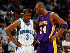 Will Chris Paul, left, and Kobe Bryant, right, become teammates on the Los Angeles Lakers? So far, the NBA says no.