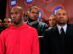 The New York Knicks waived guard Chauncey Billups, in red, to make room for free agent center Tyson Chandler.