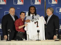 Miami Marlins president of baseball operations Larry Beinfest , left, president David P. Samson, Jose Reyes and owner Jeffrey Loria during a press conference at the MLB winter meetings at Hilton Anatole.
