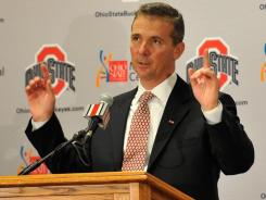 Urban Meyer speaks to the media after being introduced as the new head coach of Ohio State football on November 28, 2011 in Columbus, Ohio.