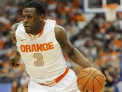 Syracuse guard Dion Waiters drives against George Washington at the Carrier Dome on Saturday.