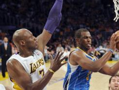 Chris Paul, right, won't be going to the Lakers but possibly the Clippers, while Lamar Odom, left, will move from the Lakers to the Mavericks.
