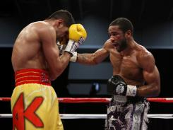 Lamont Peterson of Washington, D.C., right, defeated Amir Khan, of Bolton, England, to become the  unified super lightweight champion of the world in Washington.