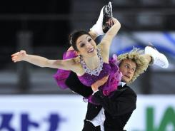 Ice dance gold medalists Meryl Davis and Charlie White, of the United States, perform their free dance at the ISU Grand Prix of Figure Skating Final, on Sunday  in Quebec City.