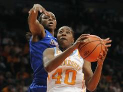 Tennessee's Shekinna Stricklen (40),  driving past DePaul's Keisha Hampton, scored 12 points in the Lady Vols' 84-61 win.