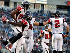 Falcons rookie WR Harry Douglas (with ball) celebrates one of his fourth-quarter TD catches with fellow WR Roddy White (84).