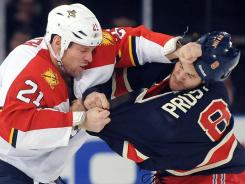 The Florida Panthers' Krystofer Barch, left, and the The New York Rangers' Brandon Prust fight in the second period at Madison Square Garden in New York.