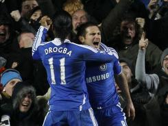 Chelsea's Frank Lampard, right, celebrates with teammate Didier Drogba after converting a penalty kick in the 82nd minute to take a 2-1 lead.