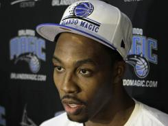 Orlando Magic center Dwight Howard, reversing course, said he might consider staying if personnel changes are made.