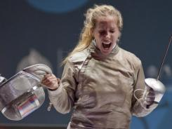 Mariel Zagunis celebrates her final point against Alejandra Benitez of Venezuela in the women's individual saber gold medal match during the  Pan American Games, at the Fencing stadium in Guadalajara, Mexico, on Oct. 25.
