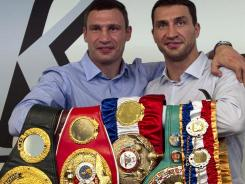 Brothers Vitali, left, and Wladimir Klitschko own all six of the heavyweight belts. Vitali will take on Sereck Chisora in February.