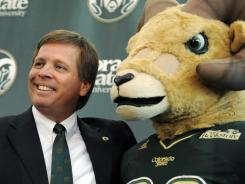 New Colorado State coach Jim McElwain poses with Cam the Ram during an introductory press conference on Tuesday.