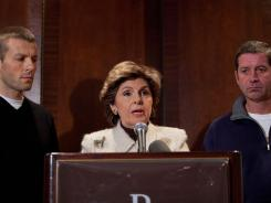 Attorney Gloria Allred speaks at a news conference with Bobby Davis (L) and Mike Lang at the Renaissance Hotel in New York Times Square on December 13, 2011 in New York City. The men are being represented by Allred in a suit against Syracuse University, and its former assistant basketball coach Bernie Fine, for his alleged sexual molestation of Davis and Lang over twenty years ago.