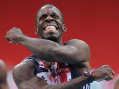 Britain's Dwain Chambers celebrates after finishing second in the men's 60m final during the French athletics indoor championships on March 6, 2011.  Chambers is awaiting a decision whether or not he can compete in the Olympics.