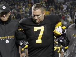 Steelers quarterback Ben Roethlisberger is helped off the field after injuring his left ankle against the Browns last Thursday,
