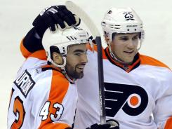 The Flyers' Marc-Andre Bourdon, left,  and Matt Carle each had a plus 3 rating in the Flyers' 5-1 win over the Capitals on Tuesday night. Bourdon was one of five Philadelphia players to score.