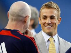 Taylor Twellman, who played for the New England Revolution, chats on the sideline before a game against the Seattle Sounders at Gillette Stadium on Sept. 4, 2010, in Foxboro, Mass.