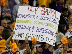 An LSU fan holds up a sign about a rematch against Alabama in the BCS title game during the SEC championship game. The Tigers routed the Georgia Bulldogs to claim the conference title.