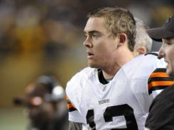 Cleveland Browns quarterback Colt McCoy leaves the field during Pittsburgh's 14-3 win. Two other Browns sustained concussions in the Browns' 21st loss in 23 games against their AFC North rival.
