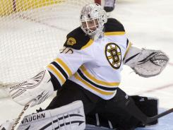 Tim Thomas made a season-high 47 saves in the Bruins' 5-2 win.