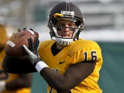 Freshman quarterback Brett Smith helped Wyoming to a bowl berth after the Cowboys posted a 3-9 record a year ago.