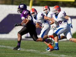 University of Wisconsin Whitewater Warhawks running back Levell Coppage finds an opening around the University of Wisconsin Platteville Pioneers in one of the longest running football rivalries.