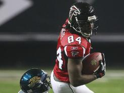 Roddy White had 10 receptions for 135 yards and two touchdowns Thursday night in the Falcons' 41-14 thrashing of the Jaguars Thursday night.