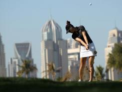 Backdropped by the Dubai skyline, Michelle Wie was four shots behind Lexi Thompson for the second-round lead at the Dubai Ladies Masters on Thursday.