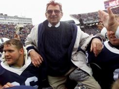 FILE: Penn State head coach Joe Paterno is celebrated for his 324th career win through defeating Ohio State after the game on October 27, 2001 at Beaver Field in State College, Pennsylvania.